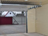 Установка секционных ворот — возможность открытия ручным или автоматическим способом